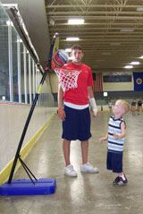 Small Child Playing Basketball with Coach